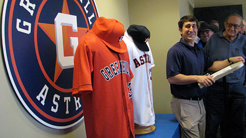 Greeneville general manager David Lane unveils the Astros' new logo and uniforms.