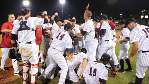 The Travelers celebrate their North Division playoff sweep of the Tulsa Drillers at Dickey-Stephens Park on Friday.