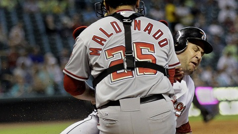 Washington Nationals catcher Carlos Maldonado, a former Timber Rattler, blocks the plate and tags out Lance Berkman in this 2010 game at Houston.