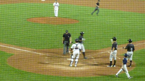 Victor Roache is greeted at home plate Saturday at Burlington after his 22nd home run of the season. Roache has tied Khris Davis for the franchise record for home runs in a season. There are two games left in the season.