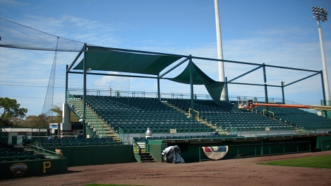 Awnings in the process of being hung at McKechnie Field.